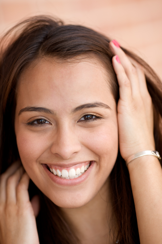 Young woman smiling about her successful tooth extraction by her dentist in Silverdale, WA.